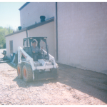 Driver running the bobcat at our previous location on Mathias Raceway Road, New Philadelphia, Ohio.